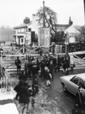 Schoolchildren waiting at level crossing, Maghull Station, Liverpool, March 1970.