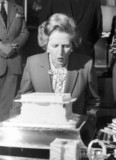 Margaret Thatcher blowing out candles, c 1983.