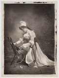 Portrait of a woman kneeling at a chair, April 1896.