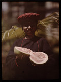 """'Little Peon with a Bombay Pumalo, India', 1914."""