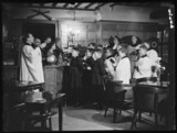 A choir rehearsing Christmas carols, Crispin Inn, Windsor Forrest, 1935.