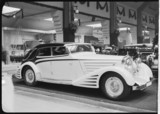 Motor car on display at a motor show, c 1934.