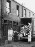 Home removals, c 1930s. Loading the bed int