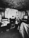 Mother and child in their slum property, Liverpool, 21 November 1949.