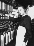 Young girl working in a cotton mill, Lancashire, c 1880.