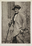 Elderly man with a walking stick.;