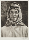 Woman wearing a headscarf, c 1935.;