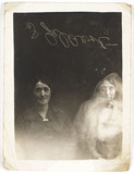 Two women with a 'spirit', c 1920.