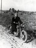 Woman on a motorbike, c 1955.