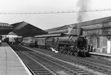 Steam locomotive 'Apollo', with goods train, Wakefield Kirkgate Station, c 1966.