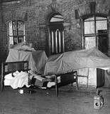 Evicted family sleeping in the street, Ashton-under-Lyne, 20 June 1950.