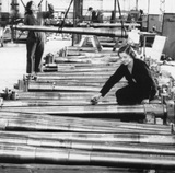Woman working in a munitions factory, Second World War, August 1942.