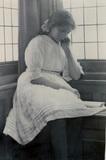 Girl reading book, 1900s.