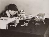 Boy with model airport, Selfridges, London, December 1936.