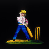 Cricketer at the stumps. Hand-coloured magi