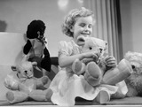 """Little girl with a teddy bear, 1949."""