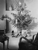 Christmas tree and presents, c 1955.