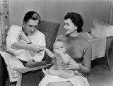 """Young couple and baby, 1956."""