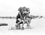 """Children playing on the beach, 1935."""