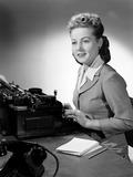"""Woman typing, c 1948."""