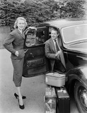 """Man and woman with a car, 1955."""