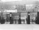 """Ticket gate at a London, Midland & Scottish Railway station, c 1924."""