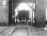 """Wagon loaded with coal in a shed at Garston docks, Liverpool, c 1926. """