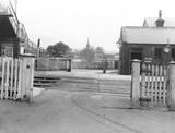 """Level crossing at Turton and Edgworth Station, Lancashire, 26 March 1928."""