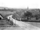"""Level crossing at Turton and Edgworth Station, Lancashire, 26 March 1928."""