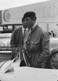 """Pierre Veyron stands beside a Bugatti Type 54 racing car, Berlin, 1933."""