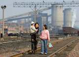 Returning from the market, Pingdingshan, Henan province, China, 2005