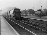 British Railways (B.R.) locomotive 35017 'Belgian Marine' on up Perth express passing Harrow 1948.