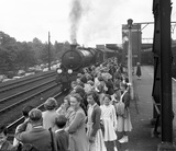 School children waiting the arrival of a train at Shenfield Station, 1955.