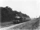 Long train including stores van, 4 coach set of 4 wheelers, clerestory and bogie coaches, c.1928