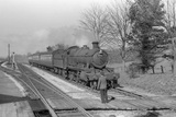 Locomotive no. 6394 at East Anstey. Taunton train entering. 7 April 1953