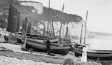 Small fishing vessels beached on the south coast, c 1910s.