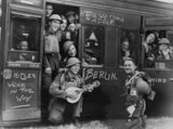 British Tommies with their own accompanist as they leave England for the Western Front.