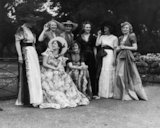A group of women modelling different gowns.