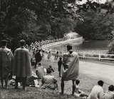 Spectators watch an Olympic cycle race, London, 1948