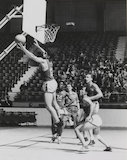 A Member of the Italian Olympic Basketball Team Jumps for the Ball