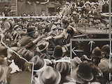 Charlie Chaplin surrounded by fans, London