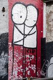 Graffiti in East London by STIK on Dalston Lane