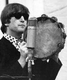 John Lennon on tambourine, 1964.