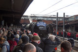Crowded platform of spectators view the Flying Scotsman locomotive as it arrives from London, February 25th 2016.