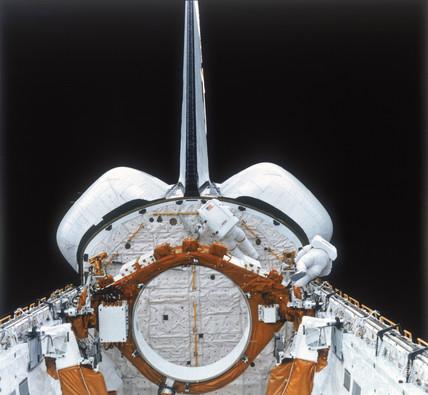 Space Shuttle astronauts on EVA, 1980s.