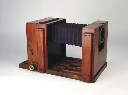 Bellows camera, c 1880.