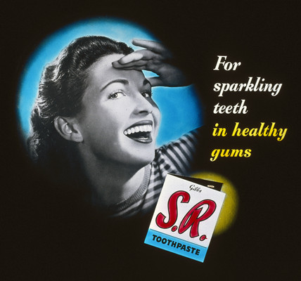 'For sparkling teeth in healthy gums' toothpaste advertisement, 1950s.
