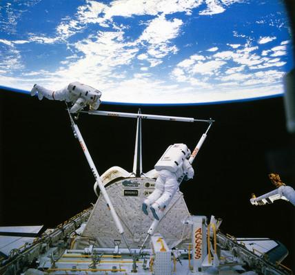 Shuttle astronauts on Extra Vehicular Activity (EVA), 1985.