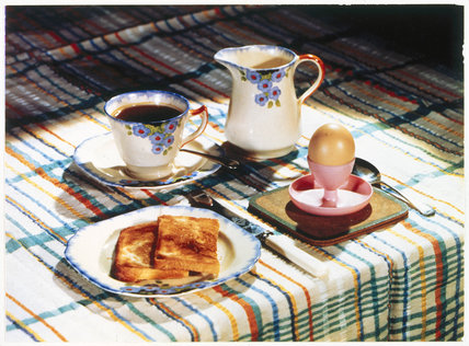 A table laid for breakfast, c 1930s.