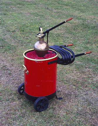 Wheeled fire pump, 1875-1925.